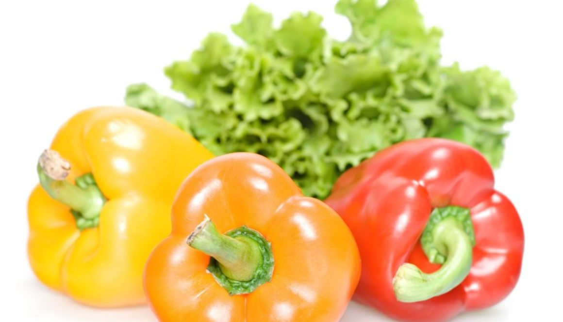 three excellent peppers isolated on white background